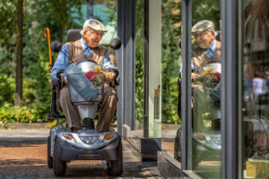 elderly man shopping on mobility scooter